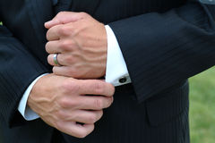 Man adjusting sleeve cuff Stock Images