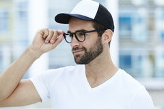 Man adjusting spectacles Royalty Free Stock Photo