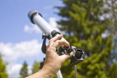 Man Adjusting Telescope Royalty Free Stock Photos