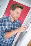 Man adjusting temperature electric boiler Royalty Free Stock Images