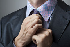 Man adjusting tie closeup Stock Photos