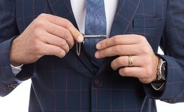 Man adjusting tie pin as fashion concept. With luxury expensive suit stock image