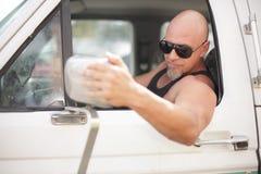 Man adjusting the vehicle mirror Stock Photos