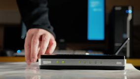 A man adjusts the antennas on the WiFi router and sends them to the right