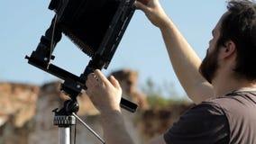 Man adjusts the retro camera close-up. Man adjusts the an old retro camera close-up stock footage
