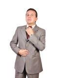 Man adjusts tie Royalty Free Stock Image