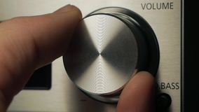 The man adjusts the volume. By turning the dimmer. volume stock video