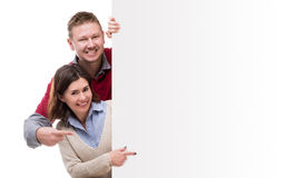 Man adm woman pointing at empty blank Stock Photo