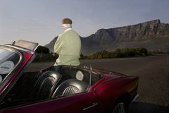 Man Admires View Leaning On Vintage Car Stock Photography