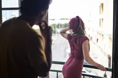 Man admiring beautiful lady in fitted dress Royalty Free Stock Photography