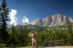 Man admiring a breathtaking alpine scenery Stock Images