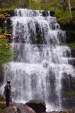 Man admiring the cascade waterfall Tupavica, located on the Stara mountain, Serbia Royalty Free Stock Images