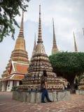 Man admiring chedis at Wat Pho, Bangkok, Thailand stock photo