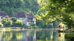 Man admiring Dordogne River at Beaulieu sur Dordogne, Correze, Limousin stock video footage