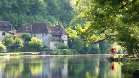 Man admiring Dordogne River at Beaulieu sur Dordogne, Correze, Limousin stock video