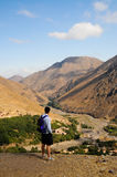 Man admiring mountain scenery, morocco. Image of man admiring scenery in atlas mountains stock photography