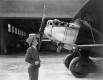Man admiring plane Royalty Free Stock Images