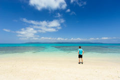 Man admiring view of tropical coral beach of Iriomote island, Okinawa Royalty Free Stock Photo
