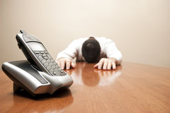 Man admits defeat waiting for a call. A man admits defeat waiting for a call Royalty Free Stock Photo