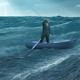 Man Adrift in tiny boat Stock Photos