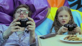 Man adult happy kid pushing buttons, gaming habit, entertainment stock video footage