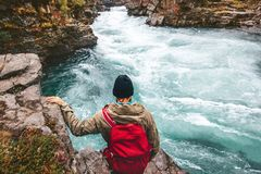 Man adventurer hiking canyoning with backpack alone stock photography
