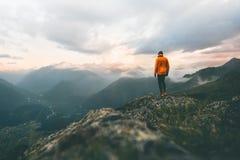Man adventurer on mountain summit hiking royalty free stock photography