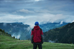 Man adventurer  watching the movement of heavy clouds Stock Images