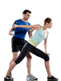 Man aerobic trainer positioning woman  Workout. One caucasian couple men aerobic trainer positioning women  Workout coach Posture in indoors studio isolated on Royalty Free Stock Image