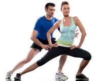Man aerobic trainer positioning woman  Workout. One caucasian couple men aerobic trainer positioning women  Workout coach Posture in indoors studio isolated on Royalty Free Stock Photography