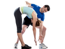 Man aerobic trainer positioning woman  Workout. One caucasian couple men aerobic trainer positioning women  Workout coach Posture in indoors studio isolated on Stock Photo