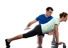 Man aerobic trainer positioning woman  Workout. One caucasian couple men aerobic trainer positioning women  Workout coach Posture in indoors studio isolated on Stock Images