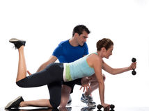 Man aerobic trainer positioning woman  Workout. One caucasian couple men aerobic trainer positioning women  Workout coach Posture in indoors studio isolated on Royalty Free Stock Photo