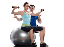 Man aerobic trainer positioning woman  Workout. One caucasian aerobic trainer positioning woman  Workout coach Posture indoors studio on white background Stock Photo