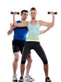 Man aerobic trainer positioning woman  Workout. One caucasian couple men aerobic trainer positioning women  Workout coach Posture in indoors studio isolated on Royalty Free Stock Photos