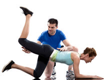 Man aerobic trainer positioning woman  Workout. One caucasian couple men aerobic trainer positioning women  Workout coach Posture in indoors studio isolated on Stock Photos