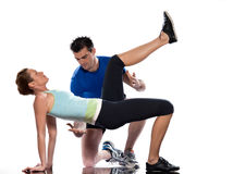 Man aerobic trainer positioning woman  Workout. One caucasian couple men aerobic trainer positioning women  Workout coach Posture in indoors studio isolated on Royalty Free Stock Images