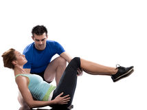 Man aerobic trainer positioning woman  Workout. One caucasian couple men aerobic trainer positioning women  Workout coach Posture in indoors studio isolated on Stock Photography
