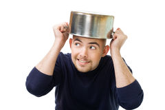 Man afraid and protecting with casserole Royalty Free Stock Photography