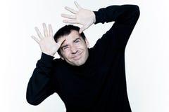 Man afraid shielding protecting his head Stock Image