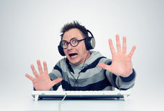Man is afraid of sitting in front of computer Royalty Free Stock Images