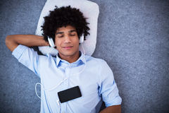 Man with afro enjoying music Royalty Free Stock Image