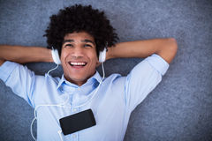Man with afro enjoying music Stock Images