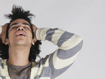 Man With Afro Hairdo Pulling Hair Back Stock Photo