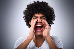 Man with afro shouting. Young man with afro shouting Royalty Free Stock Images