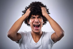 Man with afro shouting Royalty Free Stock Photos