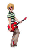 Man with afro wig with guitar Royalty Free Stock Photography