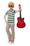Man with afro wig with guitar Stock Images