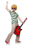 Man with afro wig with guitar Royalty Free Stock Images