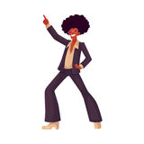 Man in afro wig and 1970s style clothes dancing disco Royalty Free Stock Photo